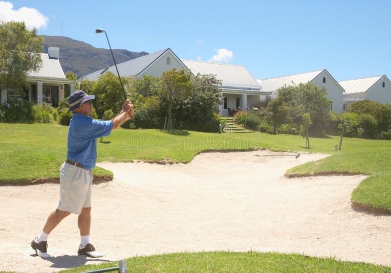 Senior golfer playing golf stock images