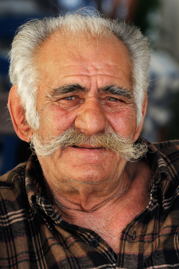 Senior Greek man with a big mustache stock images
