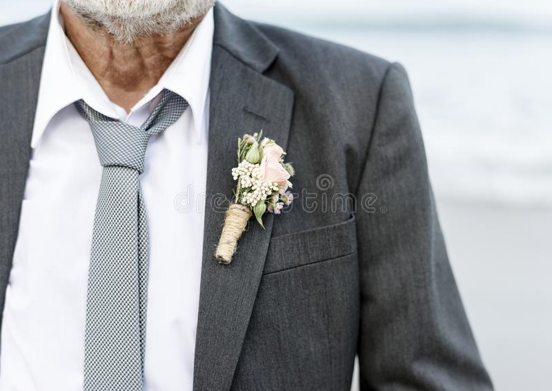 Senior groom at beach wedding royalty free stock images