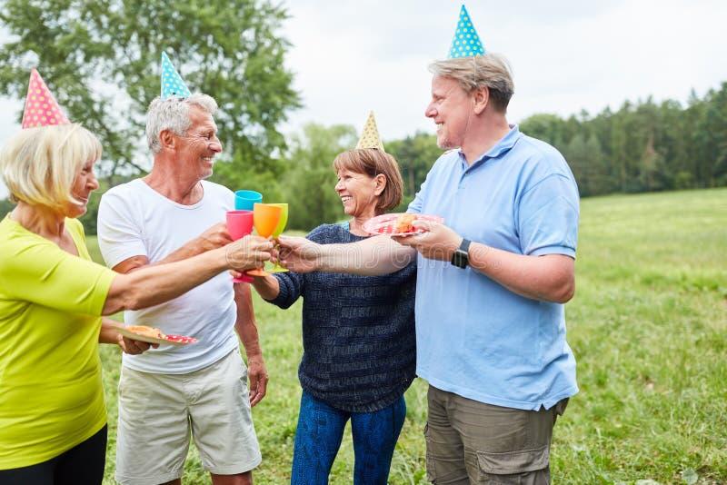 Senior group celebrates birthday together royalty free stock image