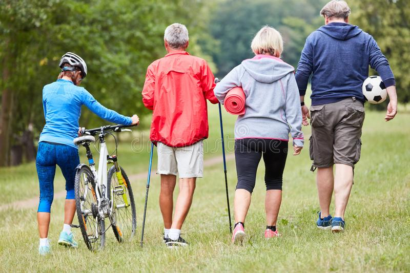 Senior group is doing sport in the park royalty free stock photography