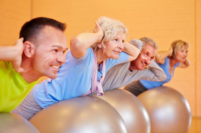Senior group exercising in fitness royalty free stock photos