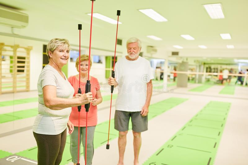 Senior group in fitness center with swinging bar stock photos