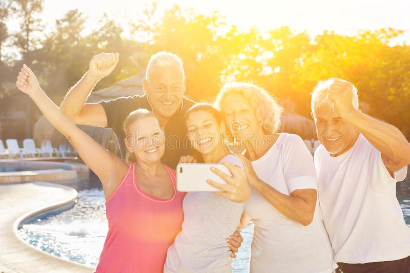 Senior group is making selfie with coach. During resort holiday royalty free stock images