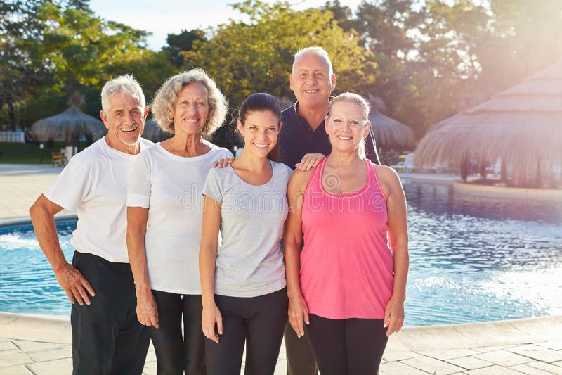 Senior group is standing by the swimming pool royalty free stock photography