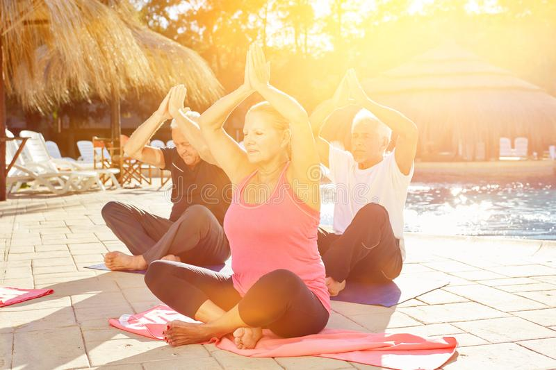 Senior group in yoga class on wellness vacation royalty free stock photography