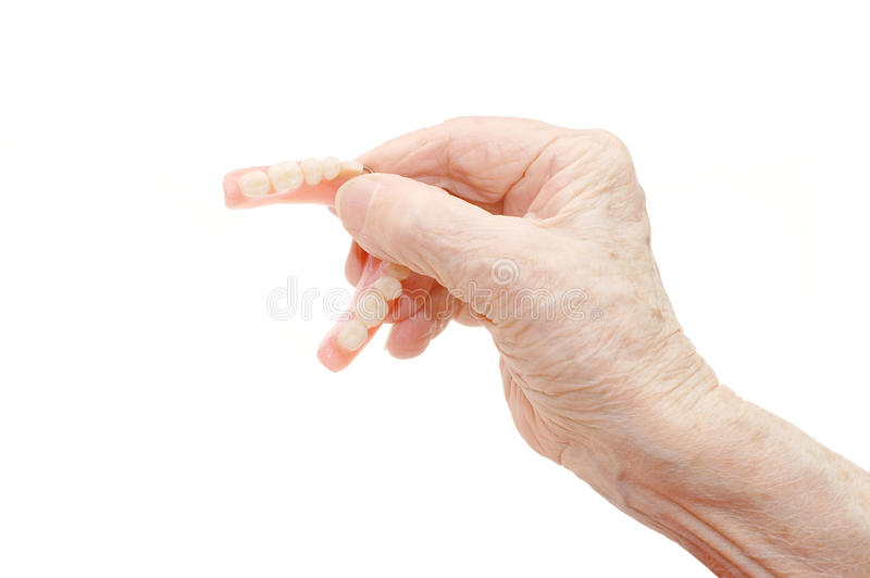 Senior hand with Dental prosthesis royalty free stock images