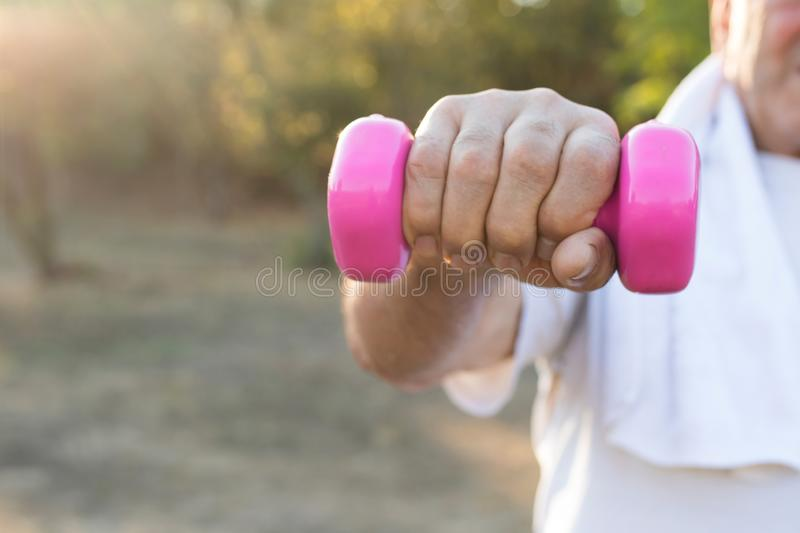 Senior hand doing outdoor sports stock images
