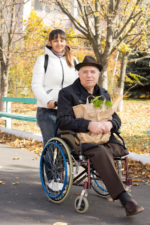 Senior handicapped man going grocery shopping royalty free stock photography