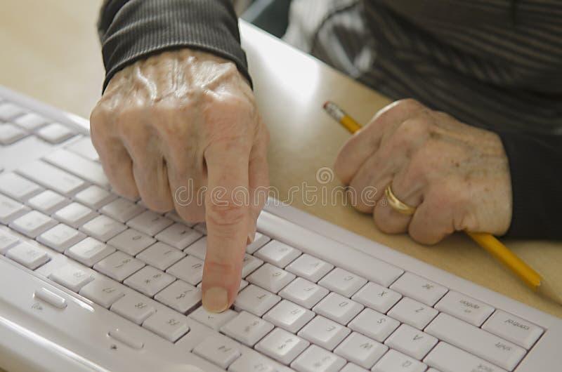 Senior hands on keyboard royalty free stock photos
