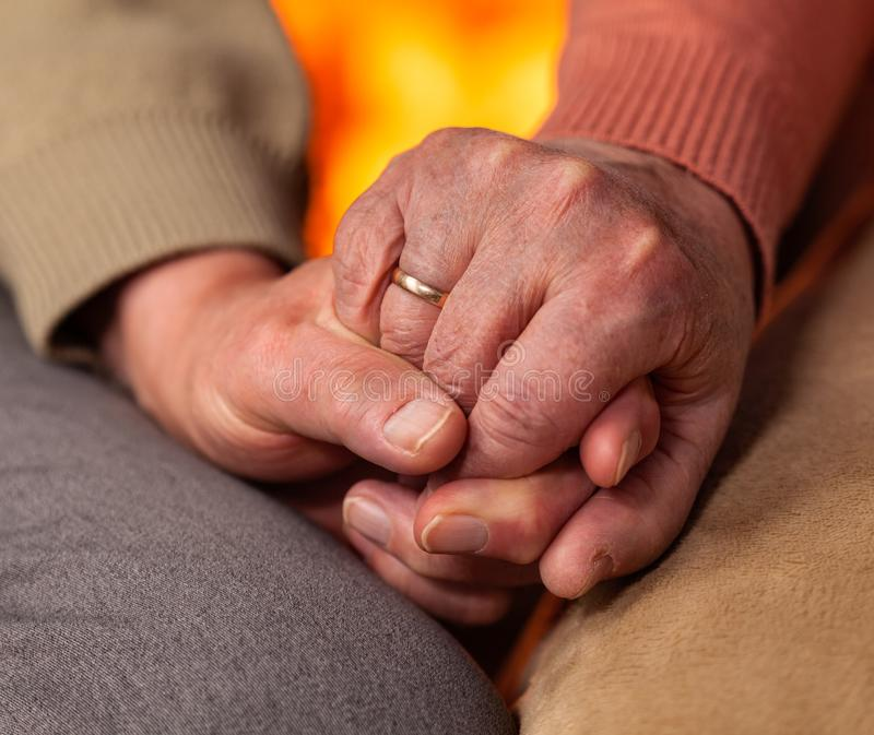 Senior hands of man and woman holding royalty free stock photography