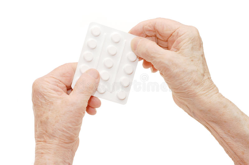 Senior hands with tablets stock images