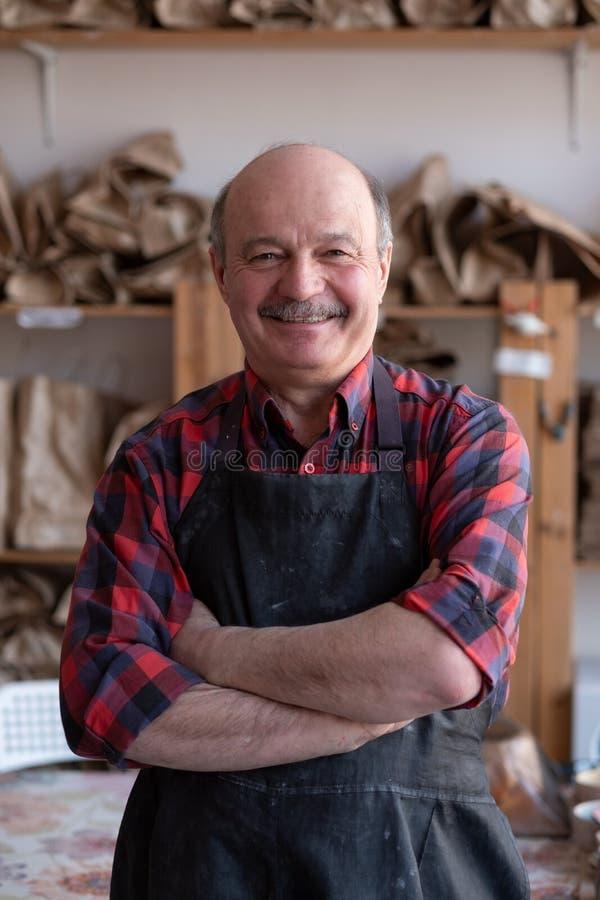 Free Senior Happy Hispanic Craftsman Standing In Studio. Royalty Free Stock Photo - 217645955