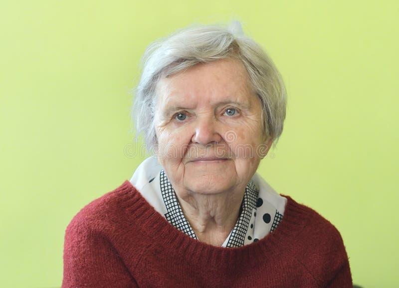 Senior happy woman. Senior happy woman in her home royalty free stock photo