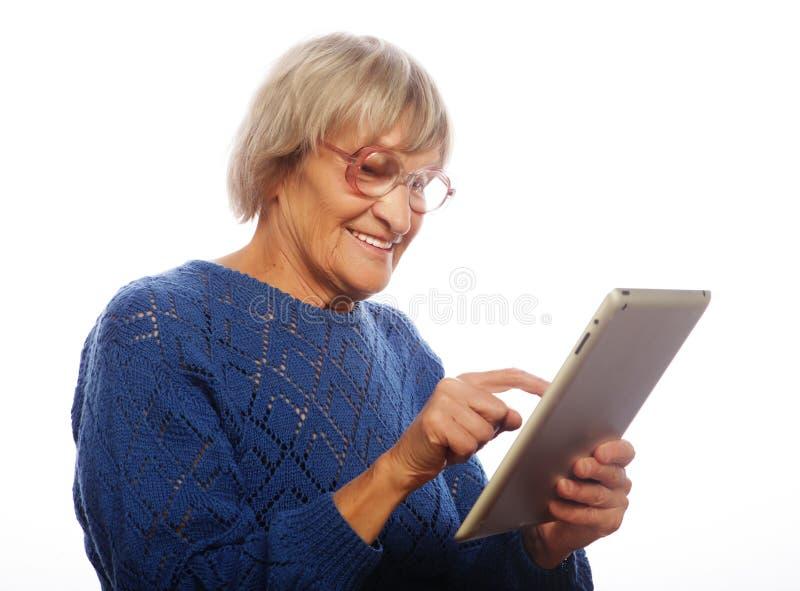 Senior happy woman using ipad royalty free stock photography