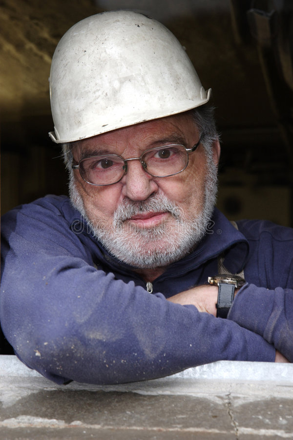 Senior in hard hat royalty free stock photography