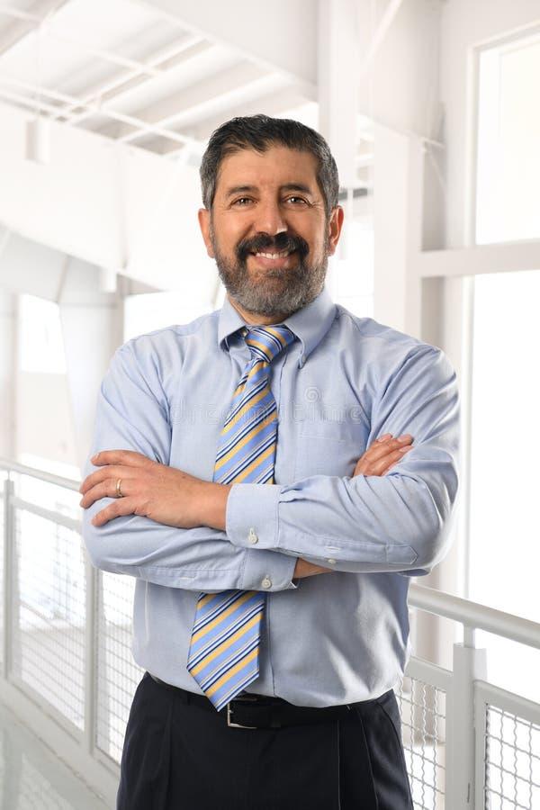 Senior Hispanic Businessman Smiling royalty free stock image