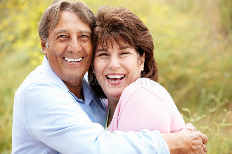 Senior Hispanic couple outdoors. Smiling royalty free stock photos