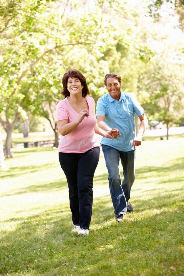 Senior Hispanic couple outdoors stock image