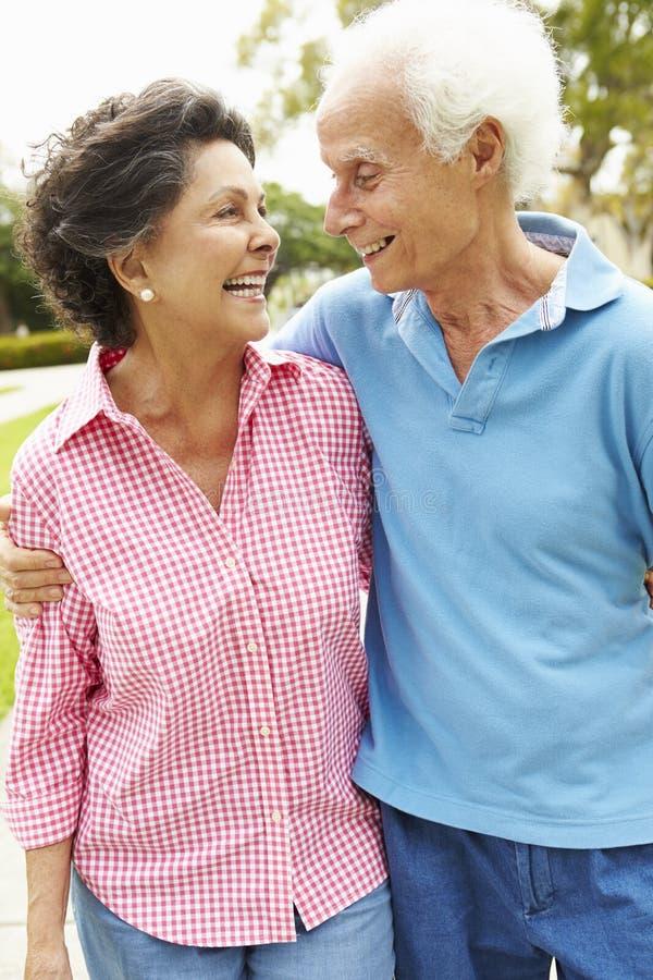 Senior Hispanic Couple Walking In Park Together stock image