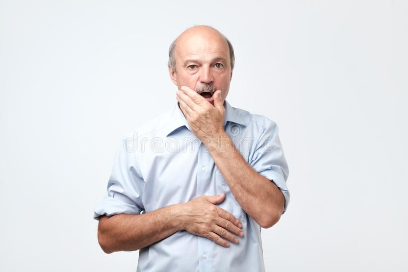Senior hispanic man looking puzzled and confused. stock photo