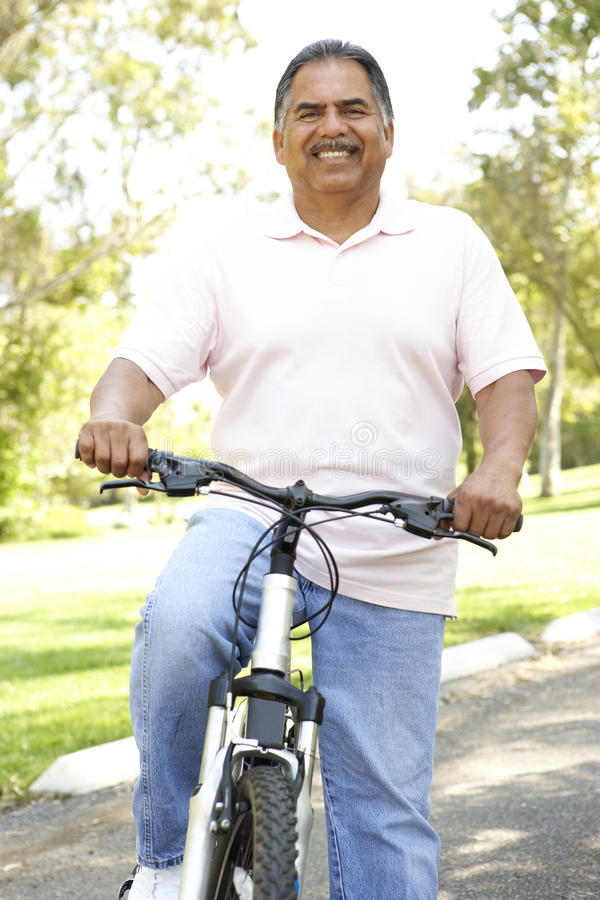 Download Senior Hispanic Man Riding Bike In Park Stock Image - Image of having, vertical: 11503089