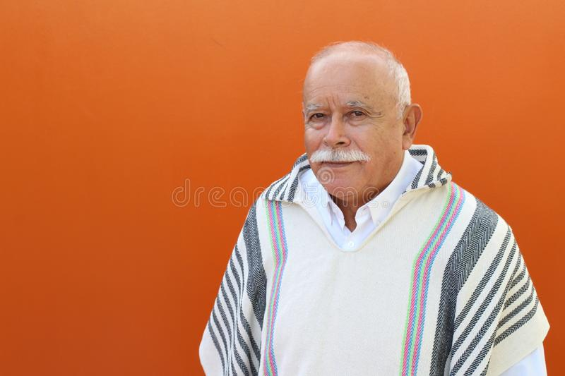 Senior Hispanic man with traditional clothing stock photo