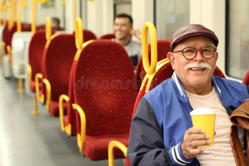 Senior Hispanic man using public transportation stock photo