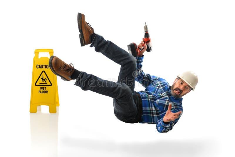 Hispanic Worker Falling on Wet Floor stock image