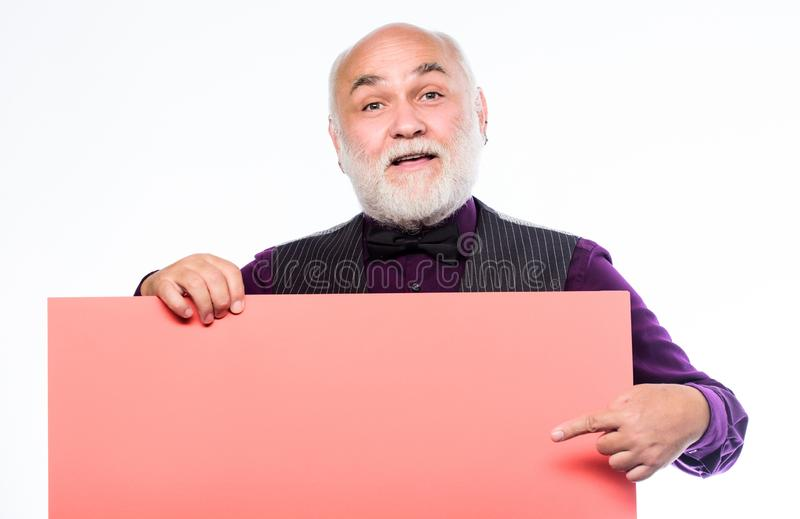 Senior holding blank sign board and looking at camera. Man bold head and gray beard hold poster for advertisement copy royalty free stock photo