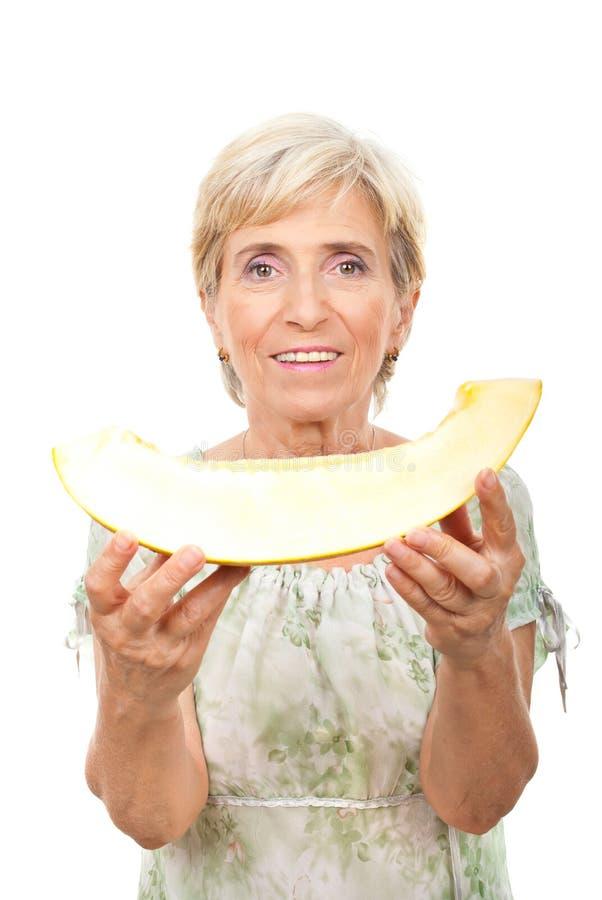 Senior holding cantaloupe royalty free stock images