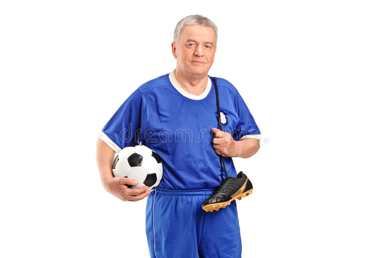 Download A Senior Holding A Soccer Shoes And Footbal Stock Image - Image: 22845685