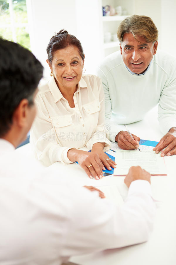 Senior Indian Couple Meeting With Financial Advisor At Home stock photography