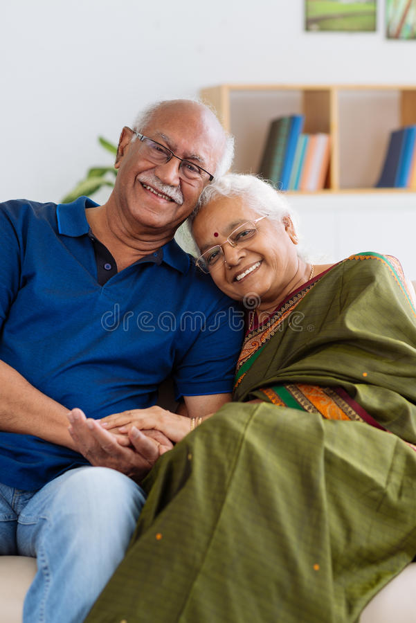 Senior Indian couple. Portrait of senior Indian couple smiling and looking at the camera