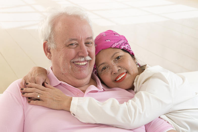 Senior interracial couple, Asian woman, Caucasian man royalty free stock photography
