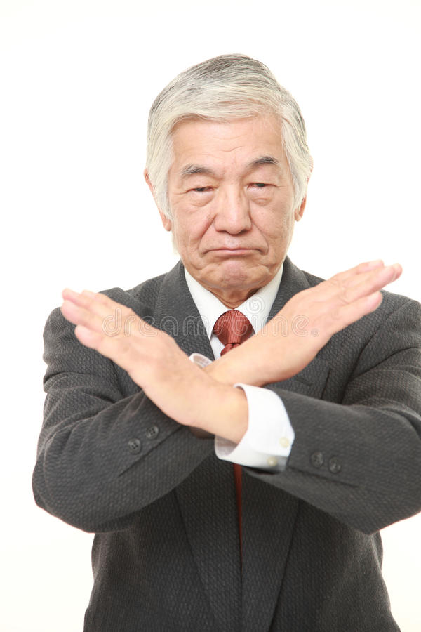 Senior Japanese businessman making NO gesture stock photos