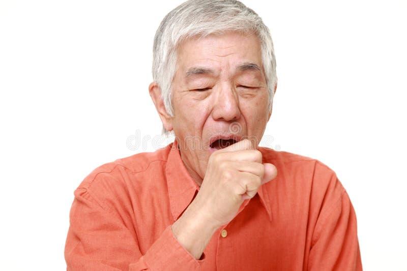 Senior Japanese man coughing. Portrait of senior Japanese man on white background royalty free stock image