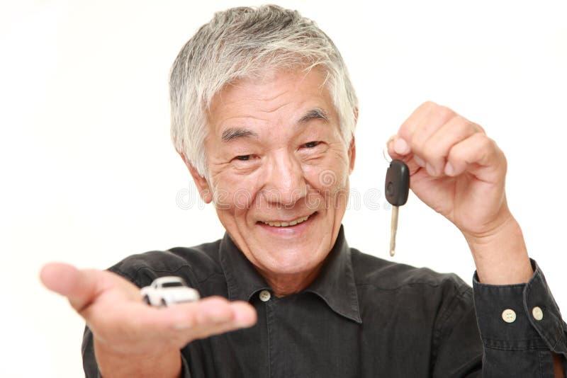 Senior Japanese man get a new car royalty free stock photo