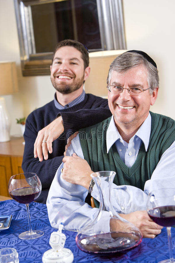 Download Senior Jewish Man, Adult Son Celebrating Hanukkah Stock Image - Image: 15150889