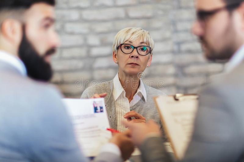 Senior job applicant having interview in office stock images