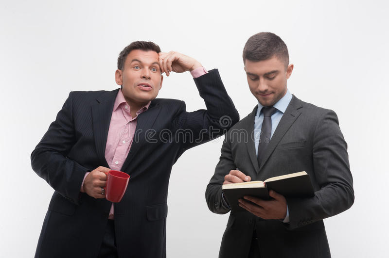 Senior and junior business people discuss royalty free stock images