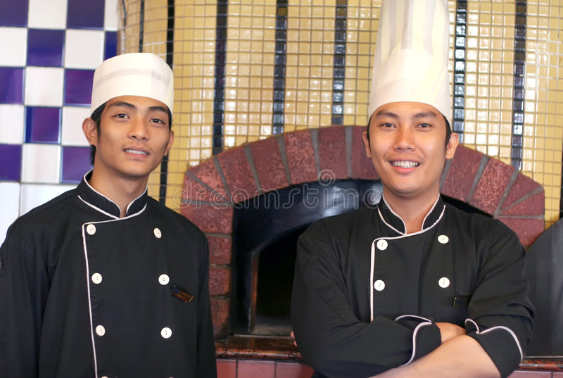 Senior and junior chef royalty free stock photography