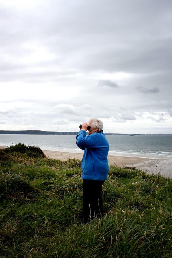 A senior lady on the coastal path stock image