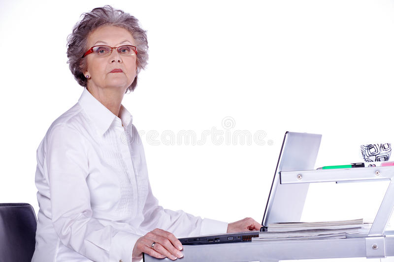 Senior lady on computer royalty free stock photography