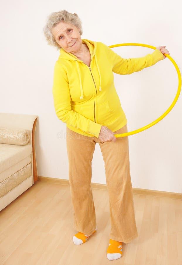 Senior Lady Doing Gymnastic Stock Image