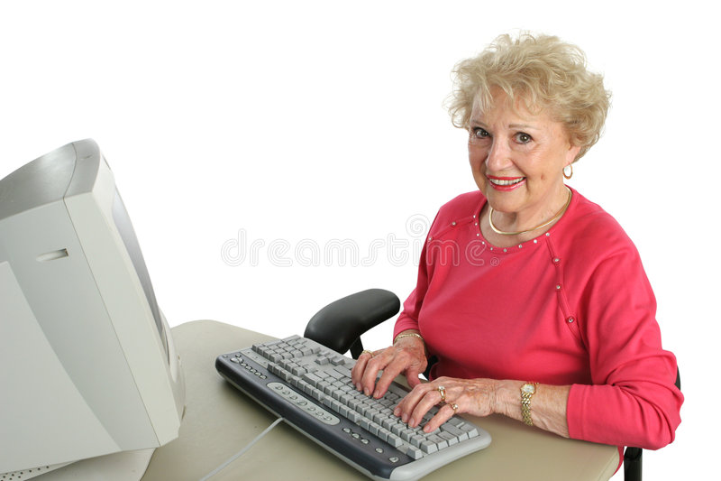 Senior Lady Enjoys Computer royalty free stock photo