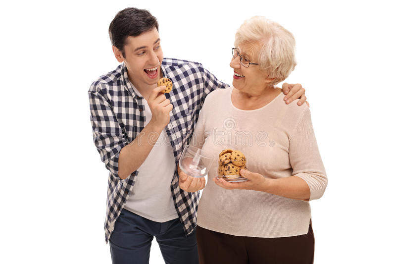 Senior lady giving cookies to a man royalty free stock image