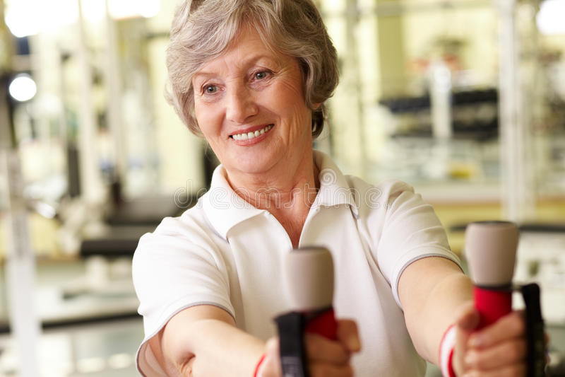Senior lady at gym royalty free stock photography