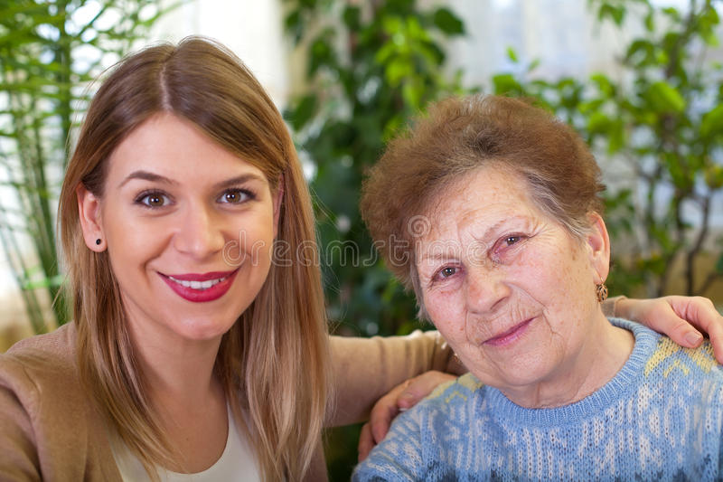 Senior lady with her beautiful granddaughter stock photography