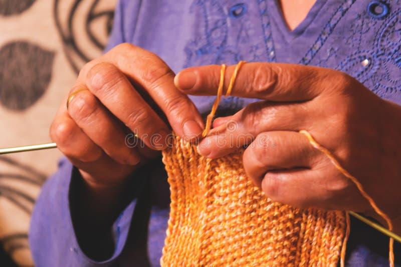 Senior lady knitting stock photo